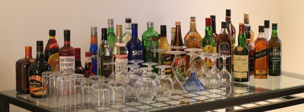 """liquor-table"" by octal is licensed with CC BY 2.0."